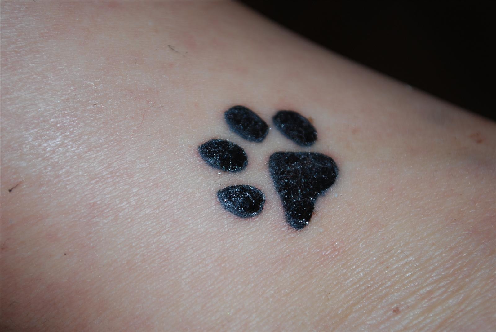 idomin på tatuering